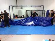 Mats laid and wrestling tarp stretched and nailed down.
