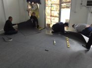 Laying down the carpet in reception.
